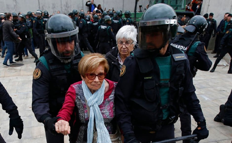 Madrid has sent thousands of extra police officers from other forces to Catalonia, which accounts for one-fifth of Spain's economy to stop the referendum from happening. AP