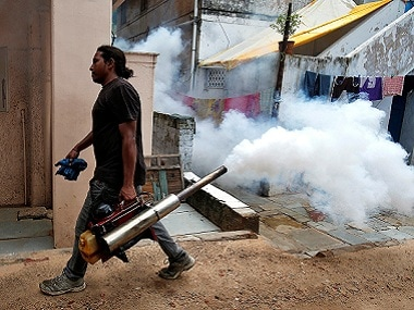 A municipal worker fumigates a residential colony to prevent the spread of dengue fever and other mosquito-borne diseases, in Ahmedabad, India, July 19, 2017. REUTERS/Amit Dave - RC1F58927B80