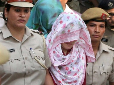 Honeypreet Insaan, the 'adopted daughter' of Gurmeet Ram Rahim Singh, along with her associate, Jagdeep Kaur being taken away by the police. PTI