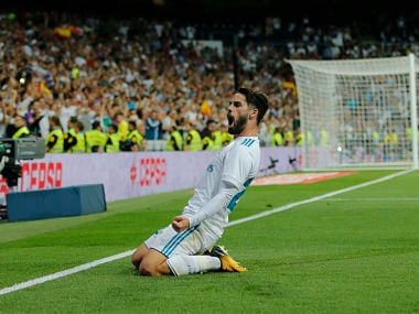 Real Madrid's Isco celebrates after scoring his second goal during a Spanish La Liga soccer match between Real Madrid and Espanyol at the Santiago Bernabeu stadium in Madrid, Spain, Sunday, Oct. 1, 2017. (AP Photo/Paul White)