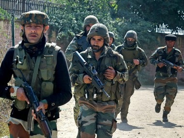 File image of security personnel running to take positions during an encounter with the militants who stormed a BSF camp near the Srinagar International Airport on Tuesday. PTI