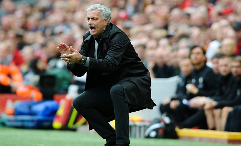 Manchester United coach Jose Mourinho reacts on the sidelines during the English Premier League soccer match between Liverpool and Manchester United at Anfield, Liverpool, England, Saturday, Oct. 14, 2017. (AP Photo/Rui Vieira)