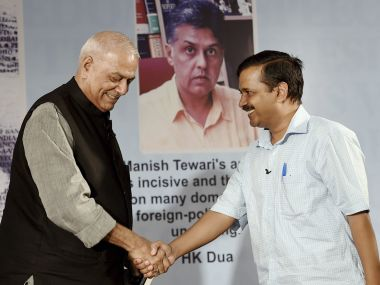 Delhi Chief Minister Arvind Kejriwal and senior BJP leader Yashwant Sinha at the release of Congress leader Manish Tewari's book launch in Delhi on Thursday. PTI