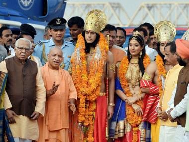 Uttar Pradesh Governor Ram Naik and Chief Minister Yogi Adityanath with artistes dressed up as Lord Rama, Sita and Lakshman during Deepotsav celebrations in Ayodhya on Wednesday. PTI