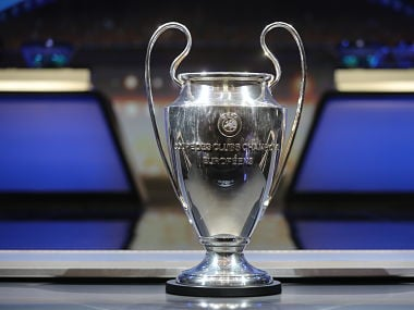 The Champions League Trophy stands on display during the UEFA Champions League football group stage draw ceremony in Monaco on August 24, 2017. / AFP PHOTO / VALERY HACHE