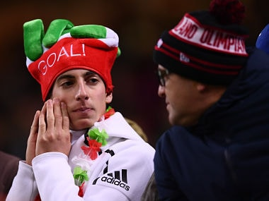 Italy's supporters react at the end of the FIFA World Cup 2018 qualification football match between Italy and Sweden, on November 13, 2017 at the San Siro stadium in Milan. Italy failed to reach the World Cup for the first time since 1958 on Monday as they were held to a 0-0 draw in the second leg of their play-off at the San Siro by Sweden, who qualified with a 1-0 aggregate victory. / AFP PHOTO / Marco BERTORELLO