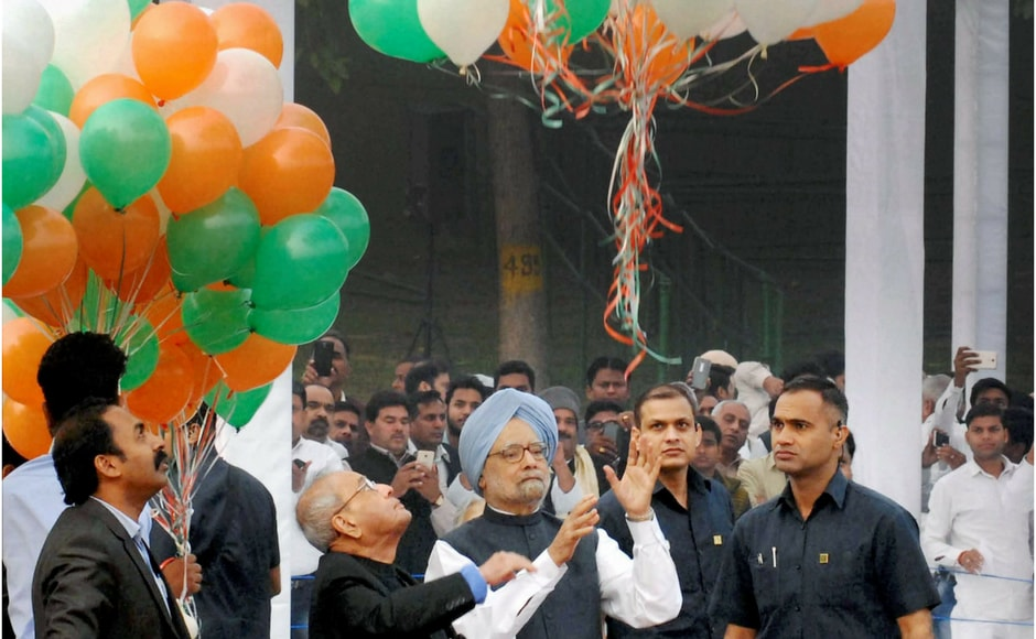 Former president Pranab Mukherjee and former prime minister Manmohan Singh released tricoloured balloons on the occasion of Pandit Jawaharlal Nehru's 128th birth anniversary, in New Delhi on Tuesday. PTI