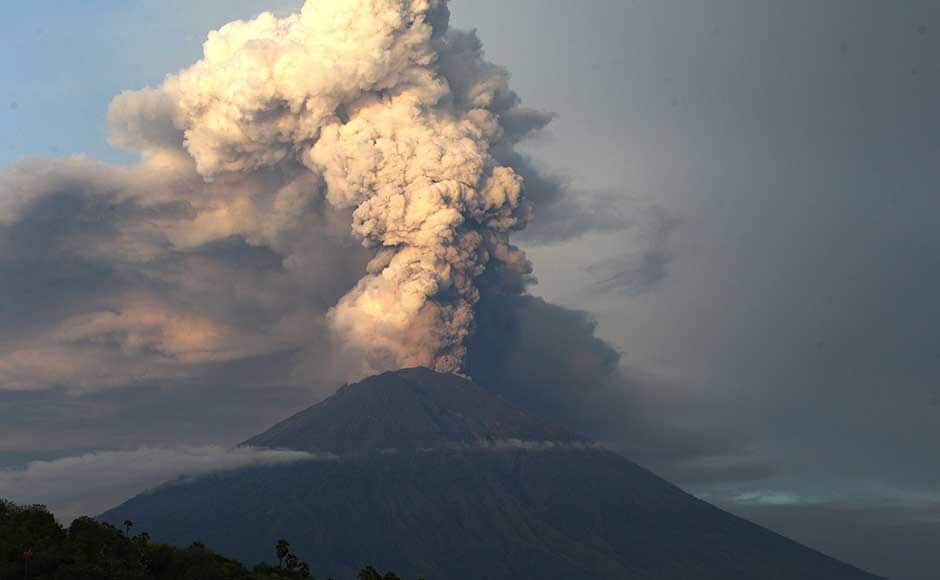 Indonesia on Tuesday extended the closure of the airport in Bali for a second day as ash from a volcano swept the island, stranding thousands of tourists. Authorities tried to persuade villagers near the erupting mountain to leave their houses. AP