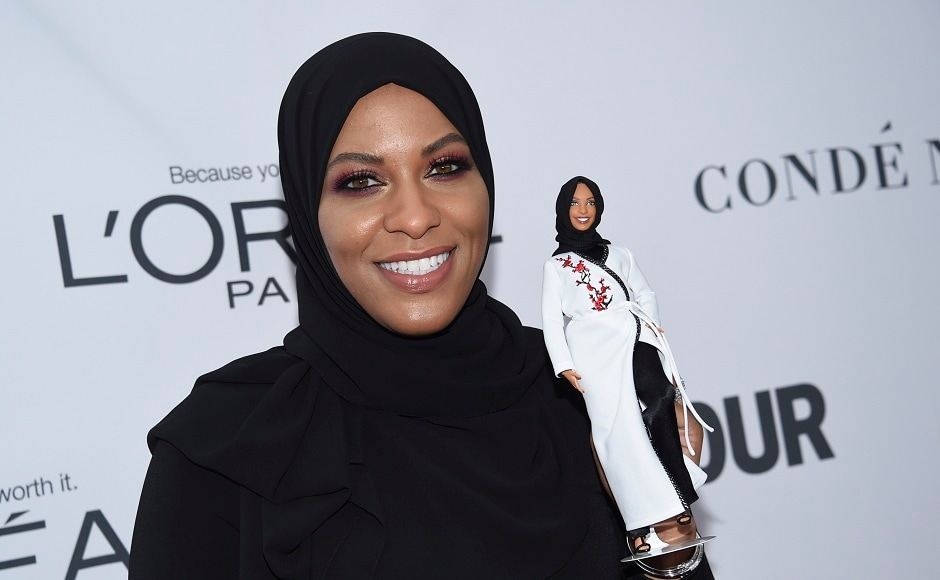 Ibtihaj Muhammad holds a Barbie doll in her likeness.Image from AP