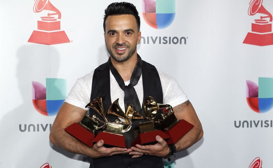 Luis Fonsi poses in the press room with the four awards for his song,