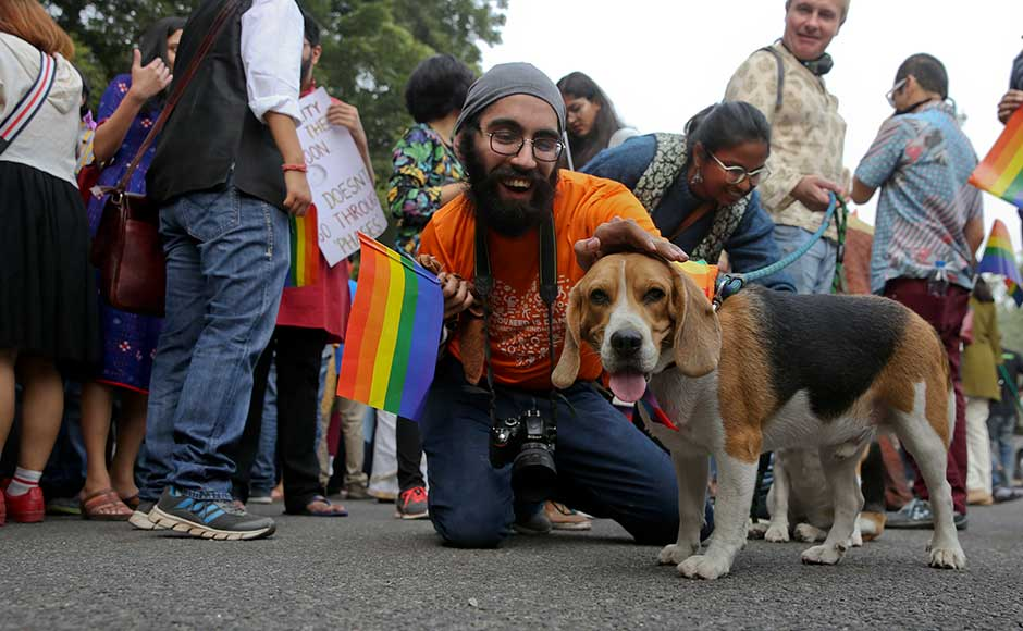 Over the past decade, homosexuals have gained some degree of acceptance in India, especially in big cities. Many bars have gay nights, and some high-profile Bollywood films have dealt with gay issues. A participant poses with a pet dog as gay rights activists and their supporters march during the parade. AP