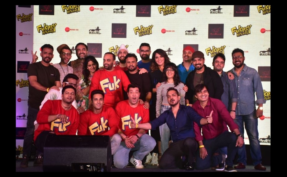 The whole cast of the Fukrey franchise poses together during the audio launch of the film.
