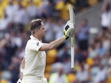 Australia's Steve Smith waves at the crowd as he leaves the field on Saturday. AP