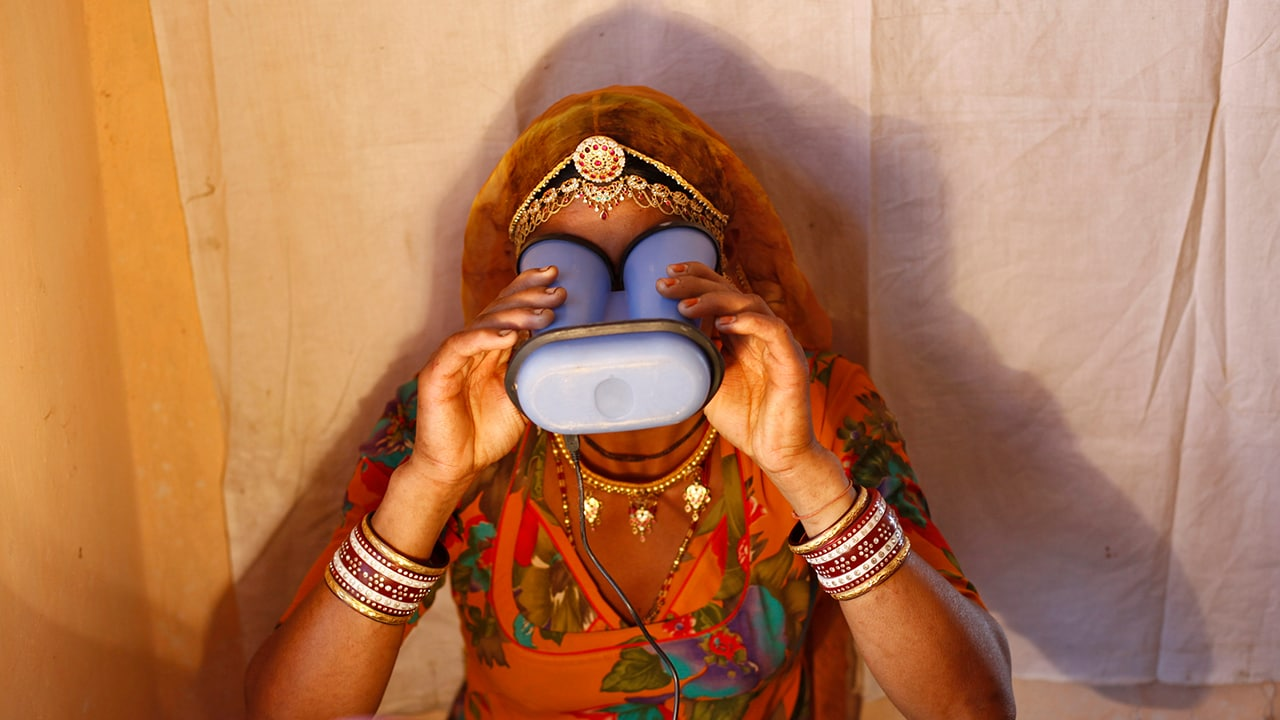 Aadhaar woman using iris scanner uidai Reuters