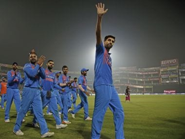 India's Ashish Nehra waves to the crowd as he bids farewell at the end of his last international match. AP