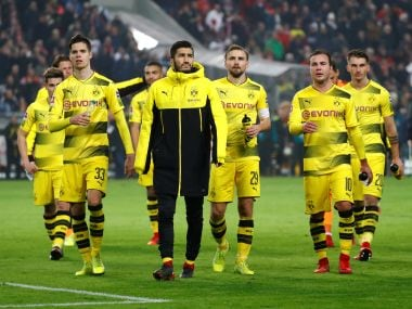 Borussia Dortmund players look dejected after the game against Vfb Sttutgart. Reuters