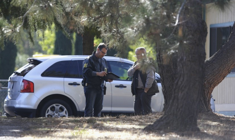 Law enforcement officers at an elementary school in Rancho Tehama Reserve, where a gunman opened fire. AP