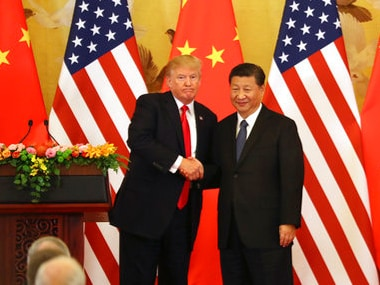 US president Donald Trump and Chinese counterpart Xi Jinping shakes hands during a joint press conference in Beijing. AP