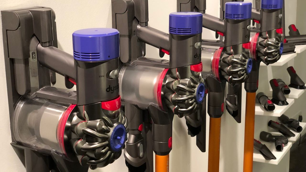 Dyson vacuum cleaners tethered to the charging ports