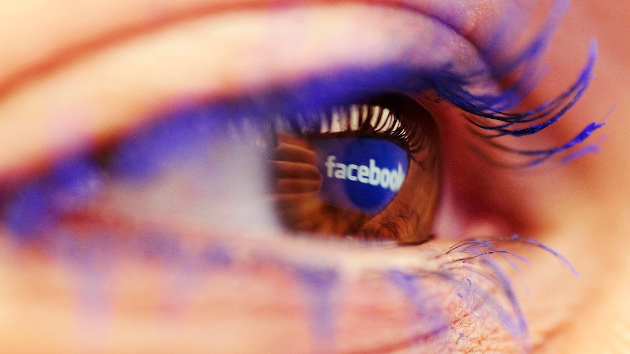 A Facebook logo reflected in the eye of a woman is seen in this picture illustration taken in Skopje November 6, 2014. Picture take November6. REUTERS/Ognen Teofilovski (MACEDONIA - Tags: BUSINESS LOGO) - LR1EABA15LWI6