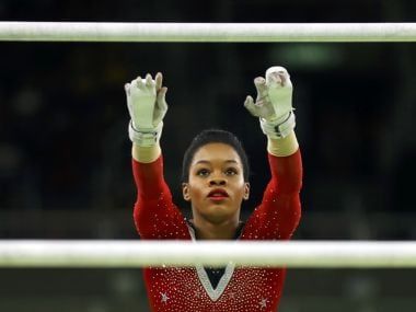 Gabrielle Douglas of USA competes in the women's uneven bars final at the Rio Olympics. REUTERS