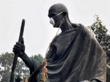 Delhi air pollution: MLAs tie protective masks on Mahatma Gandhis statue to protest AAP govts inaction