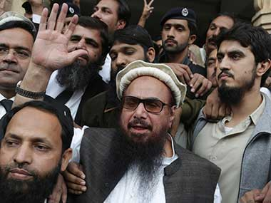 Hafiz Saeed, head of the Pakistani religious party, Jamaat-ud-Dawa, waves outside a court in Lahore, Pakistan. AP