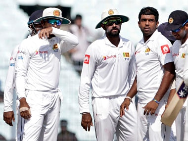 Sri Lanka's Dilruwan Perera, without cap, celebrates with teammates the dismissal of India's Ravindra Jadeja, right, during the fifth day of their first test cricket match in Kolkata, India, Monday, Nov. 20, 2017. (AP Photo/Bikas Das)