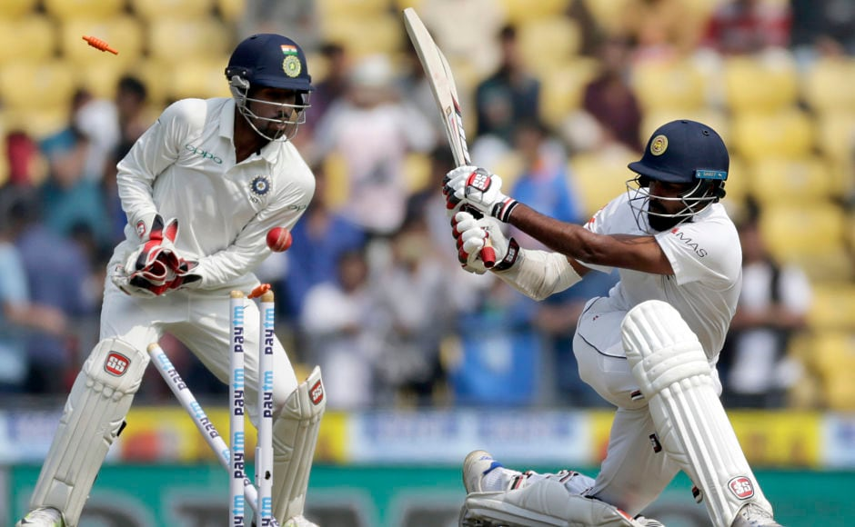 Sri Lanka's Lahiru Thirimanne, right, is bowled out by India's Ravichandran Ashwin during the first day of their second test cricket match in Nagpur. AP