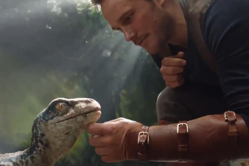 Jurassic World: Fallen Kingdom first glimpse reveals Chris Pratt petting adorable baby raptor