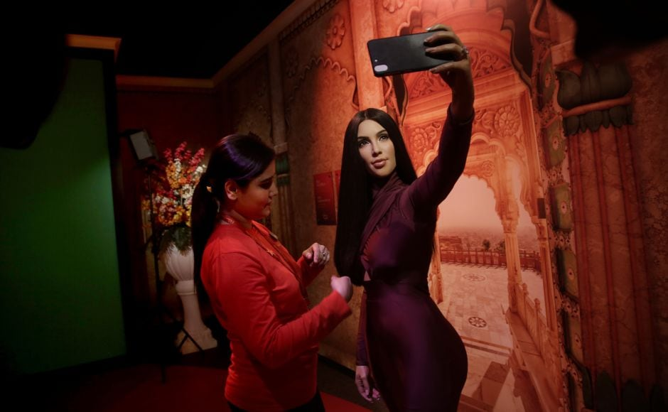 A Madame Tussauds Wax Museum staffer touches the hair of a wax figure of American reality television personality, socialite, actress, businesswoman and model Kim Kardashian. AP