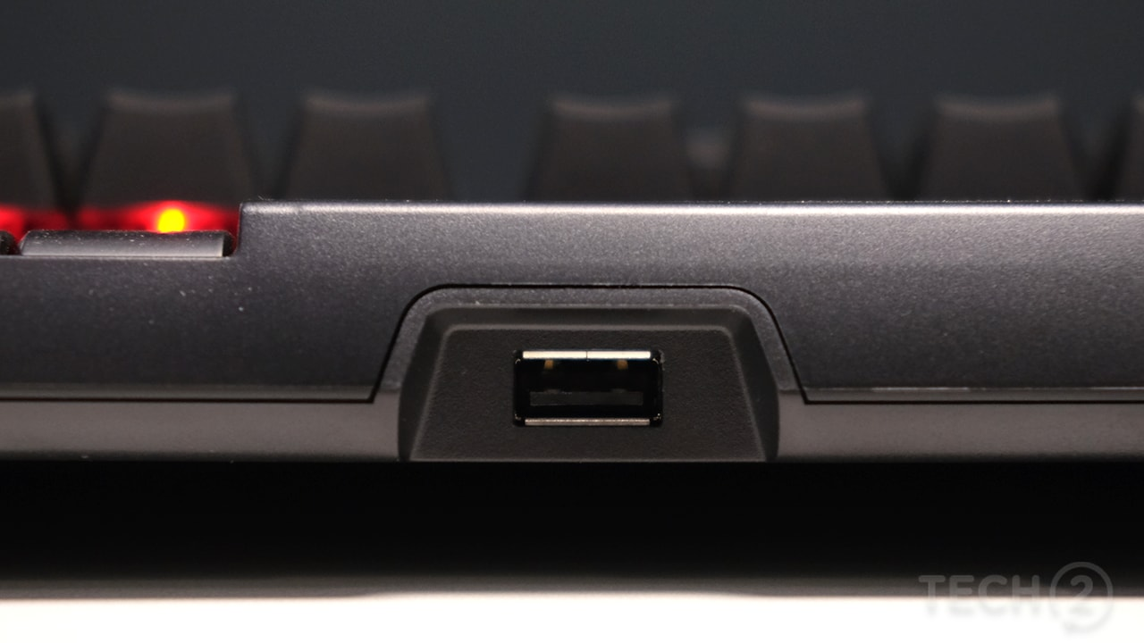 A single USB pass-through port graces the rear