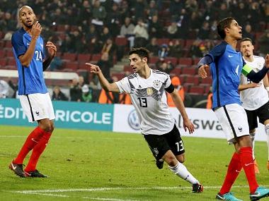 Germany's Lars Stindl celebrates besides France's Steven N'Zoni and Raphael Varane after scoring his side's second goal. AP