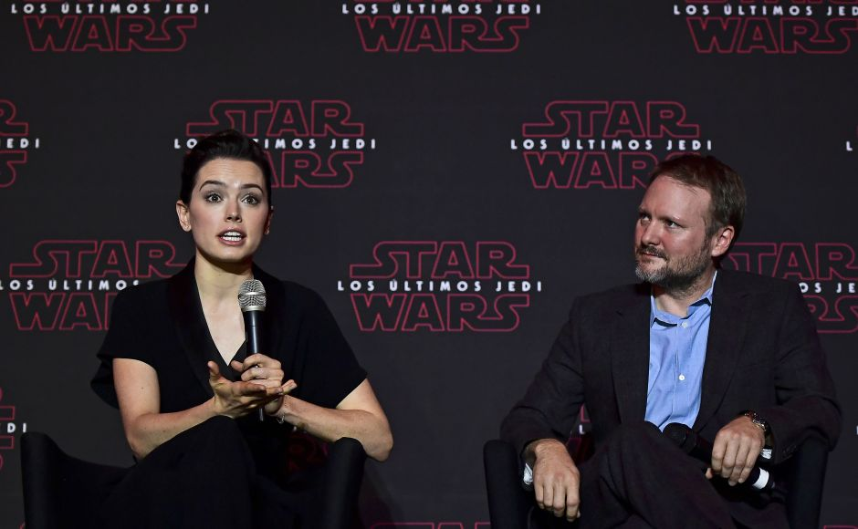 Daisy Ridley (who plays Rey in Star Wars: The Last Jedi) speaks during the press conference to promote the film as Rian Johnson looks on. AFP