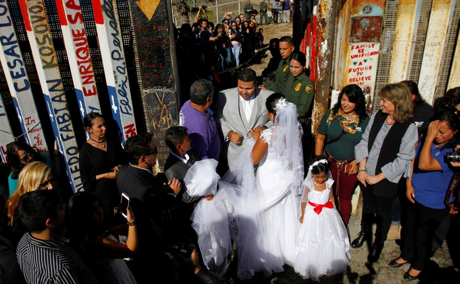 The border patrol guards on 18 November opened a gate along the United States and Mexican border to allow few families who were separated due to deportation, to reunite and converse with each other as a part of 'Opening the Door of Hope'. Reuters