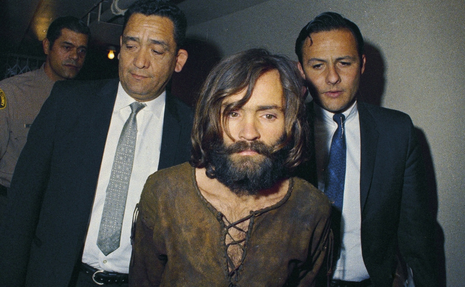 File image of Charles Manson being escorted to his arraignment on conspiracy-murder charges in connection with the Sharon Tate murder case in 1969. AP