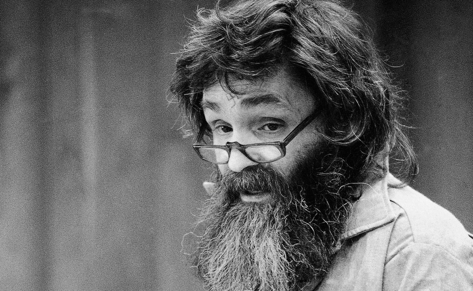 File image of convicted mass murder Charles Manson reading a rambling statement at his parole hearing in San Quentin, California in 1986. Manson had said he would go to Libya, Iran, South America or France if released. AP