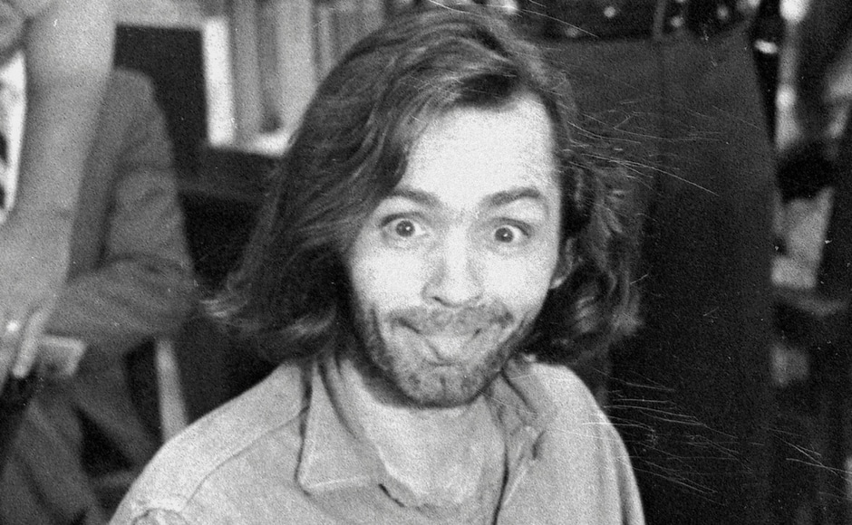In this 1970 file image, Charles Manson sticks his tongue out at photographers as he appears in a Santa Monica, California, courtroom, charged with the slaying of musician Gary Hinman. AP