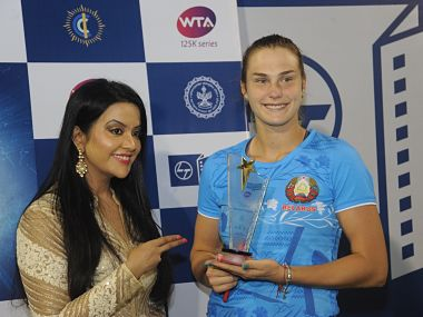 Aryna Sabalenka (right) receives the winner's trophy from Chief Patron, Amruta Fadnavis. Mumbai Open