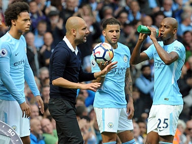 File photo of Manchester City's coach Pep Guardiola talking to his players. AP