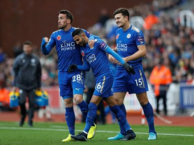 """Soccer Football - Premier League - Stoke City vs Leicester City - bet365 Stadium, Stoke-on-Trent, Britain - November 4, 2017 Leicester City's Riyad Mahrez celebrates scoring their second goal with Christian Fuchs Action Images via Reuters/Carl Recine EDITORIAL USE ONLY. No use with unauthorized audio, video, data, fixture lists, club/league logos or """"live"""" services. Online in-match use limited to 75 images, no video emulation. No use in betting, games or single club/league/player publications. Please contact your account representative for further details. - RC19D5A8F160"""