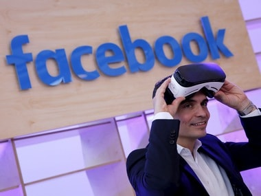 Facebook's Managing Director Northern, Martin Ott poses for the photographer with a Gear VR virtual reality headset by Oculus. Reuters