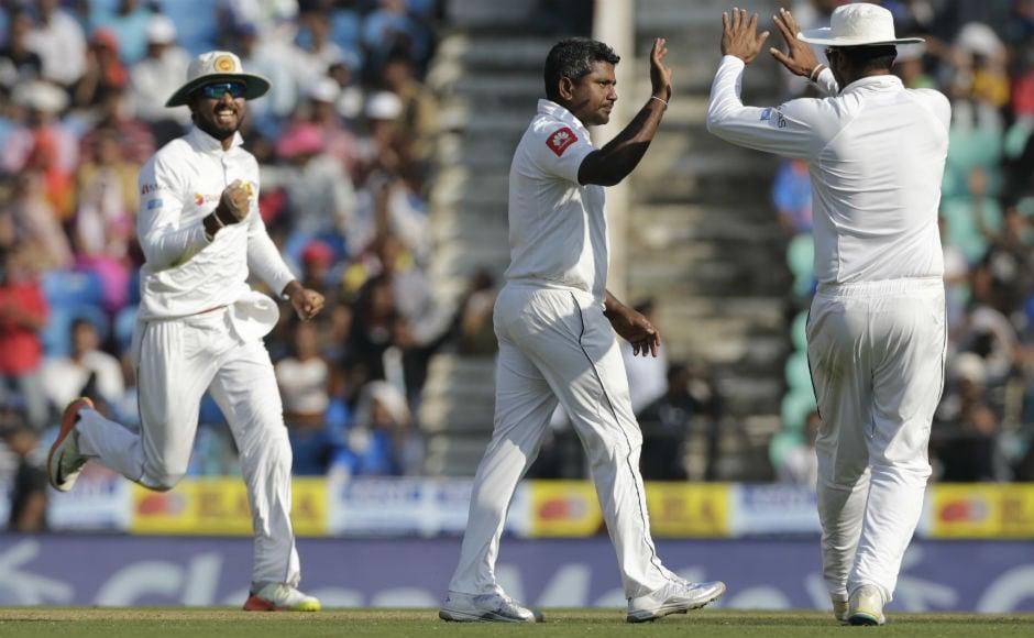 Rangana Herath celebrates the dismissal of Murali Vijay, the only Indian dismissal on Day 2. AP
