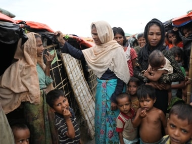 Rohingya refugee women and children gather at a refugee camp. Reuters