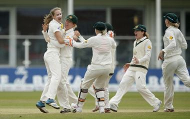 File photo of  Ellyse Perry (L) with the Australian team.  Reuters