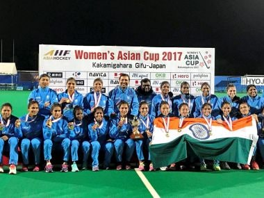 Indian women's hockey team members pose with medals and trophy as they celebrate after beat China to win women's Asia Cup hockey title. PTI