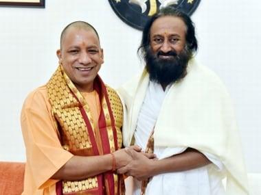 Sri Sri Ravi Shankar with UP CM Yogi Adityanath. Twitter/myogiadityanath