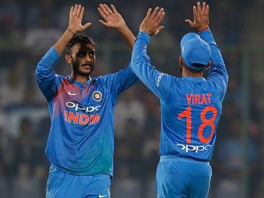 India's Axar Patel celebrates a dismissal with captain Virat Kohli in New Delhi. AP