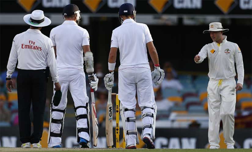Australian captain Michael Clarke (R) has some heated exchange of words with England's James Anderson (2nd L) during the fourth day of the first Ashes Test in in 2013. Reuters