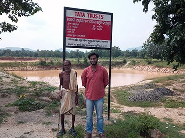 A SPARC Associate, Siddhant Panda, stands beside a desilted Pond of Pandrapita Village ,Barkani GP, Bolangir Block